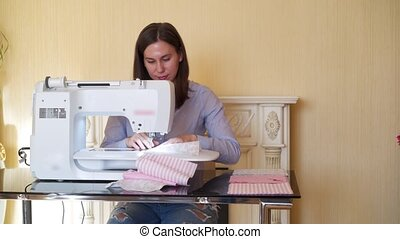 Seamstress working at sewing machine - Seamstress young...