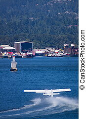 Seaplane Liftoff - Seaplane taking off over the water.