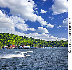 Seaplane on water - Seaplane taking off from Georgian Bay at...