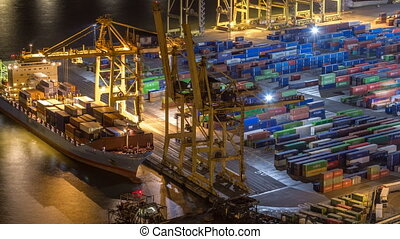 Seaport and loading docks at the port with cranes and multi-colored cargo containers night timelapse