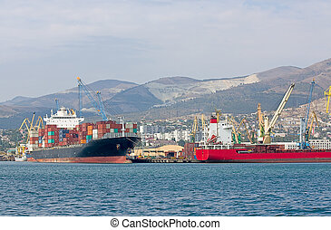 Cargo ships are loaded at port of Novorossiysk, Russia.