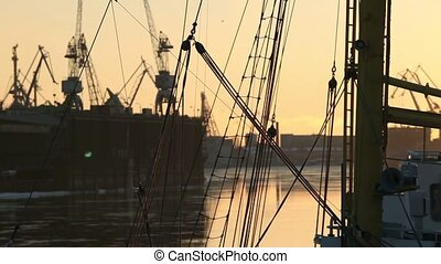 seaport in the evening at sunset - view of the harbor from...