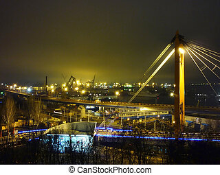 seaport with cranes at night