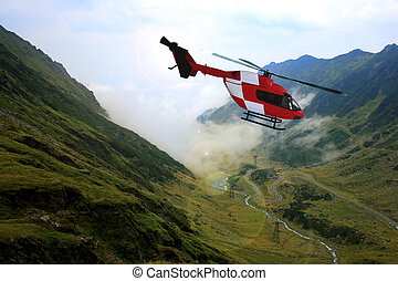 Red search and rescue helicopter, flying, horizontal