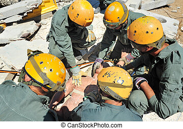 ISRASearch and rescue forces help survivors out from beneath a fallen building during an exercise on November 11, 2010 in Tel Aviv, Israel.