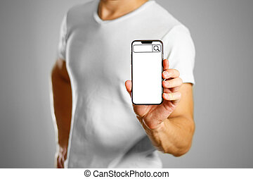Search bar on the phone screen. A man holding a black smartphone with a white blank screen. Smartphone with large screen. Close up. Isolated background