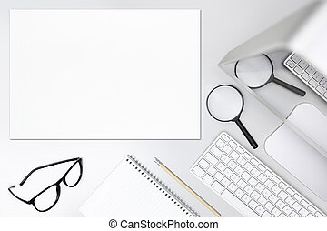 search concept, desk with magnifying glass,computer and map, top view