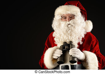 search - Portrait of Santa Claus looking through the...