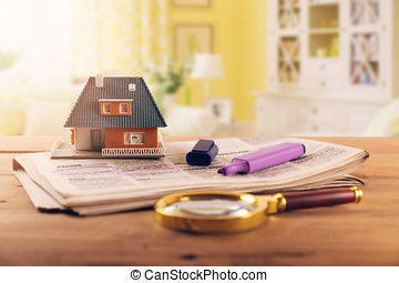 searching new house in newspaper real estate classifieds