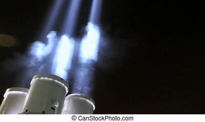 Searchlights - 4-head searchlights shining beams of light...