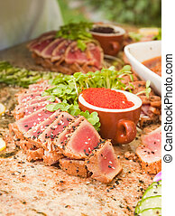 seared Ahi - seared ahi tuna with tobiko roe on a granite...
