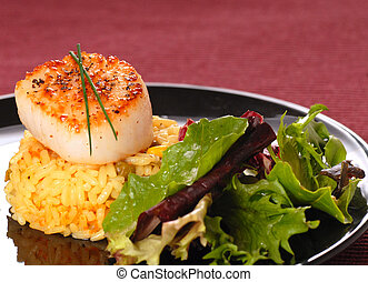Seared scallop on rice with a crisp salad