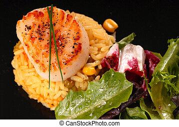 Seared scallop on saffron rice with salad