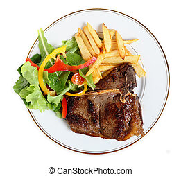 Seared T-bone steak meal from above - View from above of a...