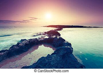 Amazing morning sun over the sea. Volcanic island of Malta. Qawra, Europe. Beauty world. Retro toning effect.