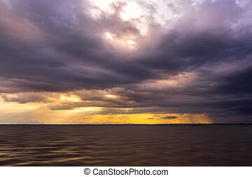 Seascape and clouds in rain season with sunlight.