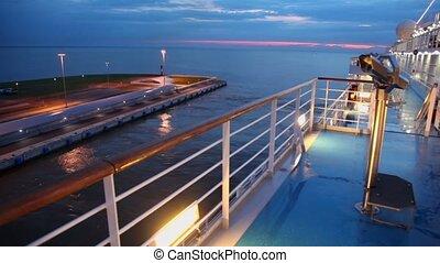Seascape and deck of huge liner on moorage in dock