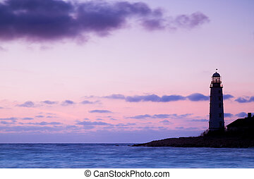 Seascape and the lighthouse on the coast
