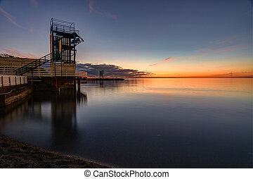 Seascape and wharf in the small bay of Anapa, Russia after sunset