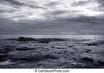Seascape at dusk. Used infrared filter. Toned blue.