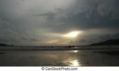 seascape at sunset reflected on wet beach sand with incoming...