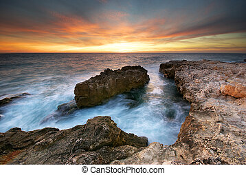 Seascape - Beautiful seascape. Sea and rock at the sunset. ...