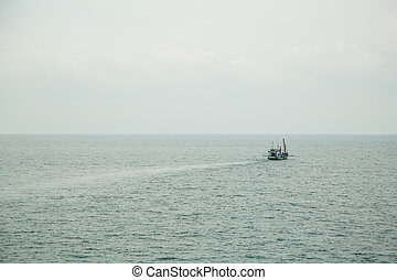 Seascape. boat on a quiet sea surface