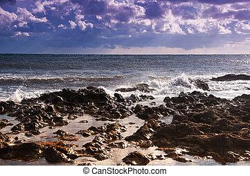 Seascape. Ebb. - Sea during the ebb. rocky seashore. Clouds...