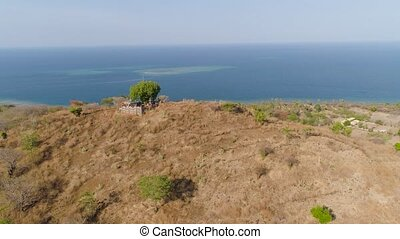 seascape in indonesia - aerial view hindu temple on hill...