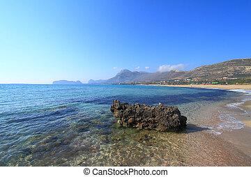Seascape of coastline with distant mountains Falasarna Crete