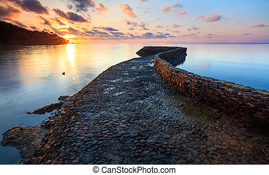 Seascape of path to the sea at sunset