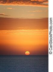 Orange sunset at the sea with sun
