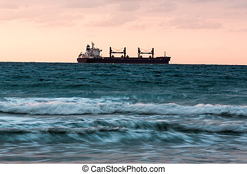 ship floating on the sunset background