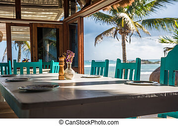 Seascape tropical beach restaurant, shallow focus