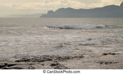 seascape, mountains in the background