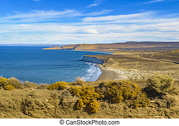 Aerial landscape scene of atlantic coastline at Punta del Marquez, a touristic viewpoint located in Chubut, Argentina.