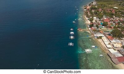 Seascape with a coastline and a lagoon - aerial footage...