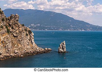 Seascape with a rock on the southern coast of Crimea