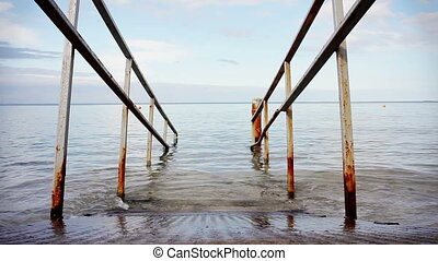 Seascape with an old rusty rails background