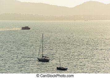 Seascape with boat and color of morning light