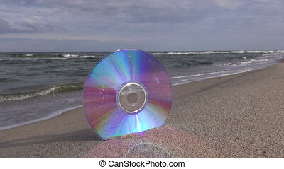 Seascape with CD in the beach sand - Seascape with CD in the...