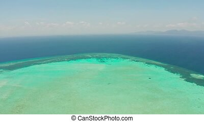 Tropical islands and coral atolls with blue water of the sea, aerial view. Balabac, Palawan, Philippines. Summer and travel vacation concept.