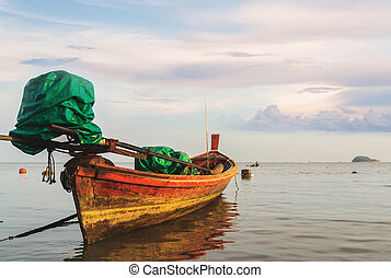 Seascape with fishing boat in morning light