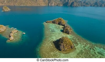 Seascape with islands in the lagoon - aerial footage small...