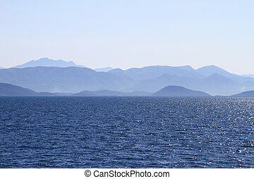Seascape with mountains in horizon