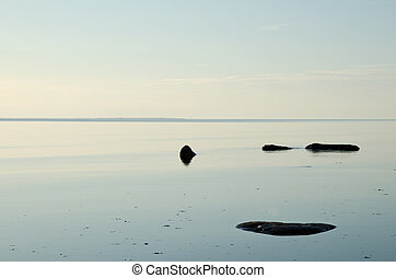 Seascape with stones in calm water