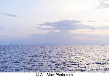 Seascape with sunset blue sky. Sunlight on water.