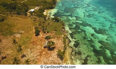 Seascape with tropical island, beach, resort, hotels. Bohol,...