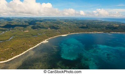 Seascape with tropical island, beach, rocks and waves....