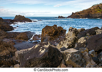 Seascape with waves crashing on the rocks in Seixal, Madeira
